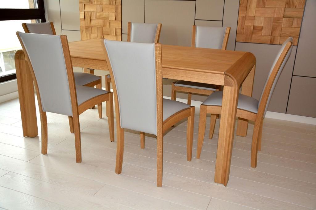 Living accesorizat cu masa din lemn masiv cu 8 scaune din lemn masiv tapitate in piele naturala gri 1024x682 1