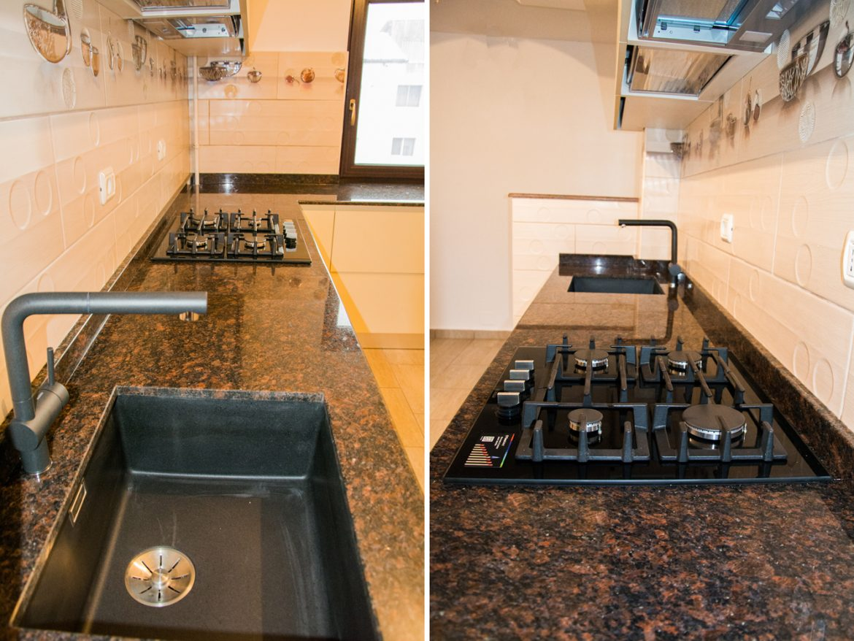 bucatarie moderna cu detaliul blatului din granit