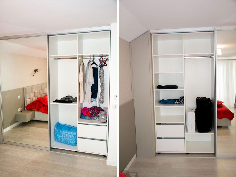 interior dulap cu detaliu pentru rafturi mobile si bara pentru umerase