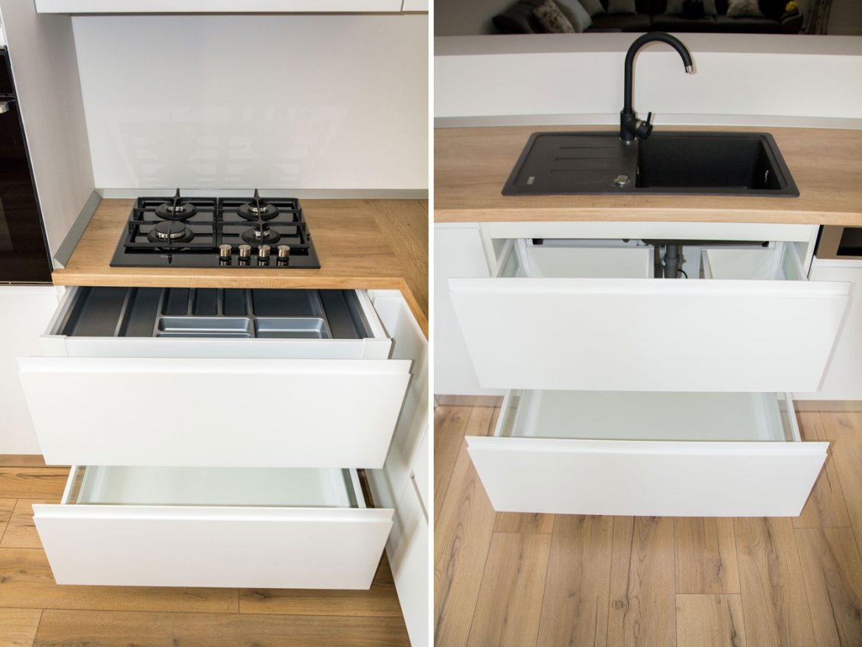 bucatarie moderna la comanda bacau cu detaliu sertarelor cu amortizare si chiuveta neagra din compozit